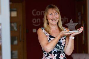 Caroline Bailey receiving her 40 year service award