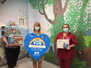 Building society donates £1,800 to help make children smile during hospital visits