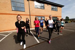 Darlington Building Society's Great North Run team present over £3,700 to charities